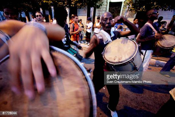 Cuban musicians beat their drums as they walk through the streets during the Camaguey carnival June 25 2008 in Camaguey Cuba The first day...