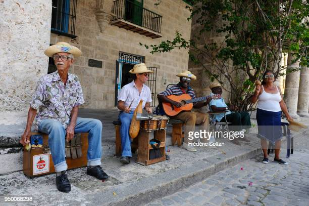 Cuban musicians play for tourists in the streets of the Havana Vieja neighborhood on August 04 2017 in Havana Cuba