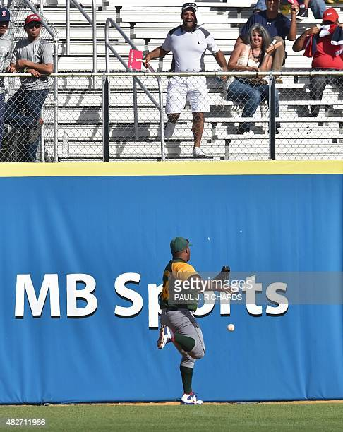 Cuban National baseball team leftfielder Alfredo Despaigne misses a long fly to center left off the bat of Dominican National baseball team...
