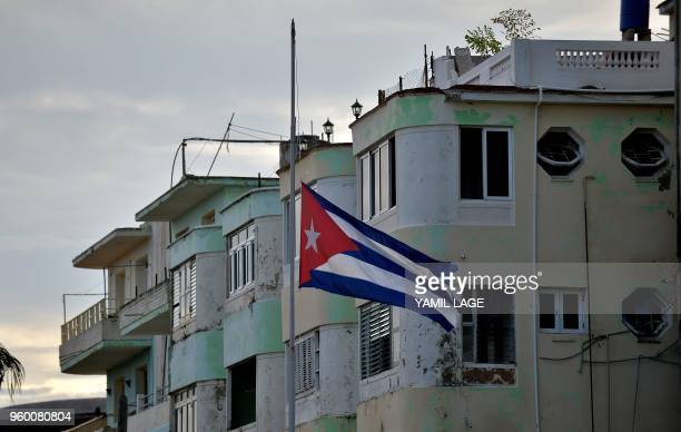 A Cuban national flag flies at halfmast in tribute to the victims of a plane that crashed shortly after taking off from Jose Marti airport kiling 107...