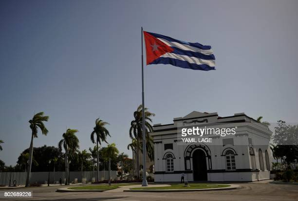 A Cuban national flag flutters in the wind on June 20 2017 at the Santa Ifigenia cemetery in Santiago de Cuba where late Cuban leader Fidel Castro ir...