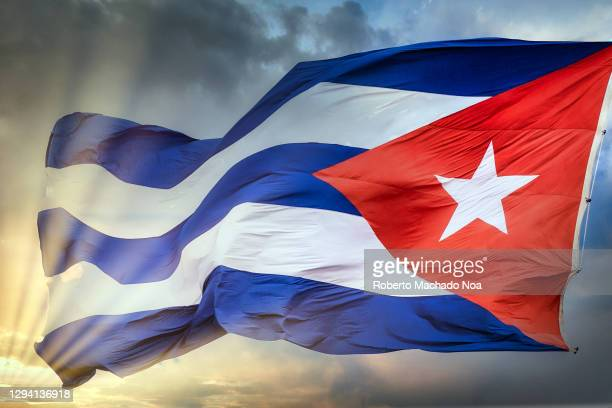 cuban national flag waving in the wind - cuban flag stock pictures, royalty-free photos & images