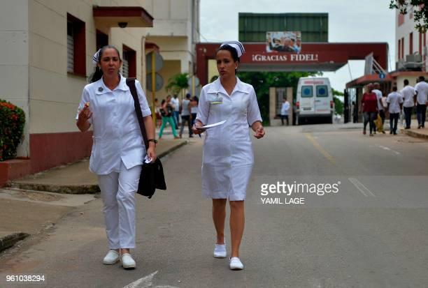 Cuban nurses walk along a street at the Calixto Garcia Hospital where the three survivors of the Cubana de Aviacion plane crash are hospitalized in...