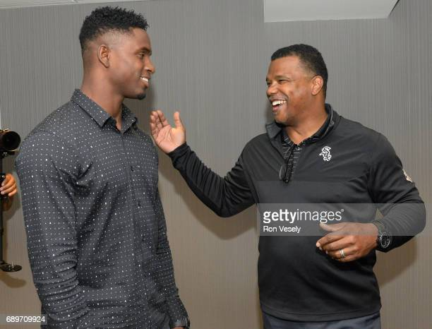 Cuban outfielder Luis Robert visits with Chicago White Sox Executive VicePresident Ken Williams prior to the game against the Detroit Tigers on May...