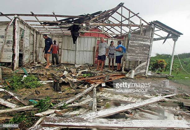 Cuban peasants look at the damages caused by storms preceding Hurricane Wilma's arrival 22 October 2005 in San Juan y Martinez province of Pinar del...