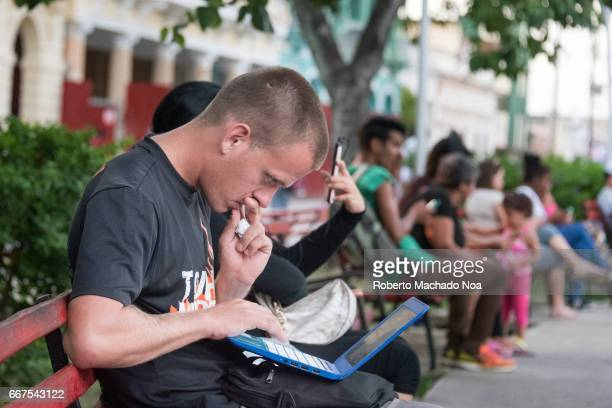 Cuban people connecting to the internet via wifi in the Leoncio Vidal plaza Due to low connection speed the service is mainly used for communication...