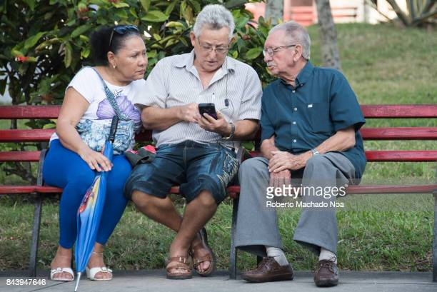 Cuban people connecting to Wifi in public areas That is the only access to internet for ordinary people in the Caribbean Island