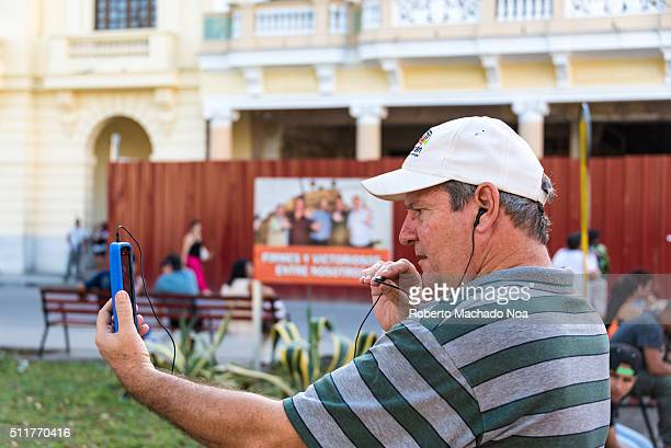 Cuban people enjoying legal paid wifi internet mainly to communicate with family abroad