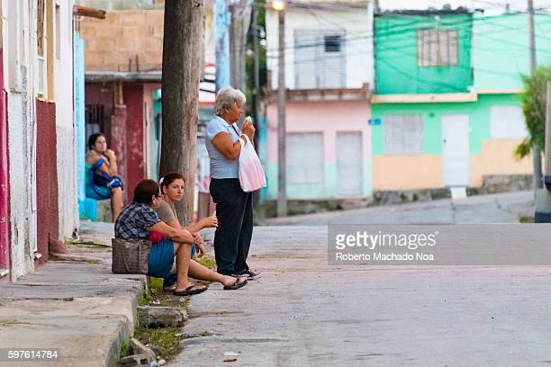 Cuban people lining up for the opening of an establishment early in the morning Cuban lifestyle or way of life