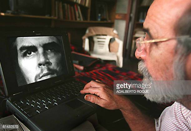 Cuban photographer Alberto Korda looks at one of his most famous pictures of Cuban Argentineborn revolutionary hero Ernesto Che Guevara on a portable...