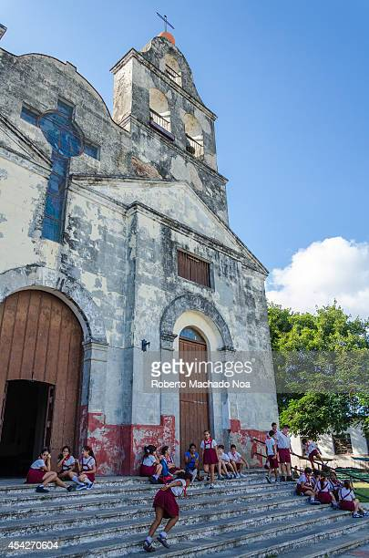 Cuban Pioneers outside La Pastora Church during a break in classes, the church is close to the city downtown and it is tourist attraction.