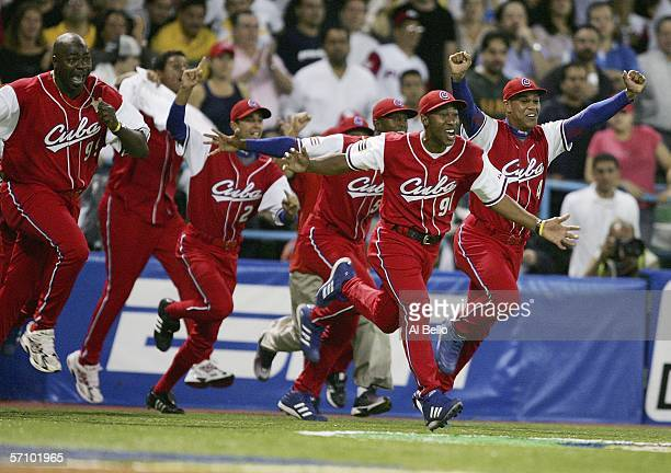 Cuban players celebrate after defeating Puerto Rico 43 during Round 2 of the World Baseball Classic on March 15 2006 at Hiram Bithorn Stadium in San...