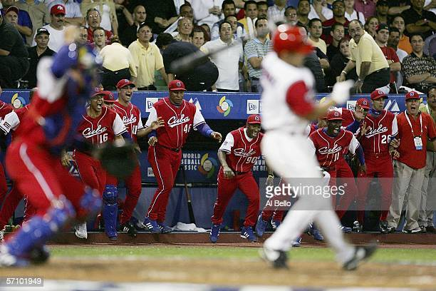 Cuban players celebrate after Ivan Rodriguez of Puerto Rico strikes out to end their game during Round 2 of the World Baseball Classic on March 15...