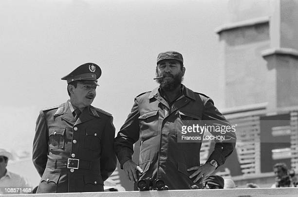 Cuban politician and Prime Minister Fidel Castro and his brother politician Raul Castro attend the traditional May Day parade on Revolution Square on...