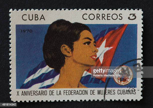 Cuban postage stamp celebrating the 10th anniversary of the foundation of the FMC or Cuban Women Federation A portrait of a woman appears in front of...
