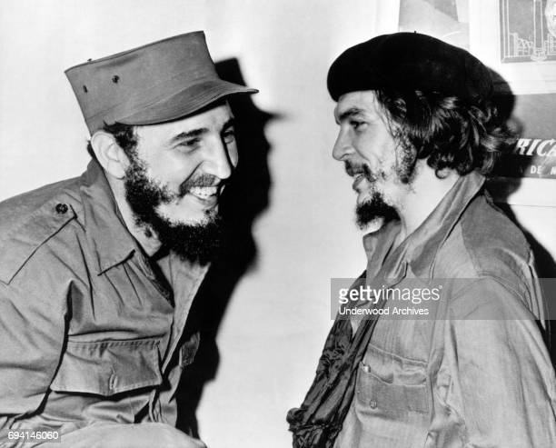 Cuban Premier Fidel Castro and his secondincommand Ernesto Che Guevara share a laugh together Cuba 1959