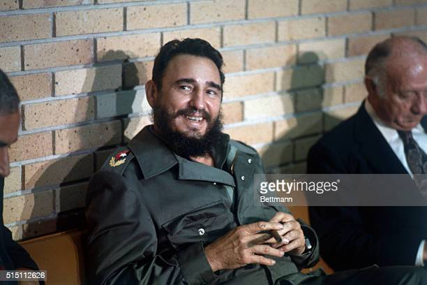 Cuban Premier Fidel Castro flashes a big smile as he sat with a cigar during an interview by American newsmen accompanying Senators Jacob K Javits...