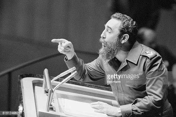 Cuban Premier Fidel Castro gestures with his finger while addressing U.N. General Assembly during his first visit to the United States in 19 years....
