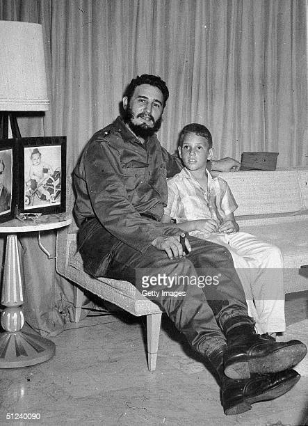 1959 Cuban premier Fidel Castro poses with his his young son Fidel Castro Jr during an appearance on an American television show