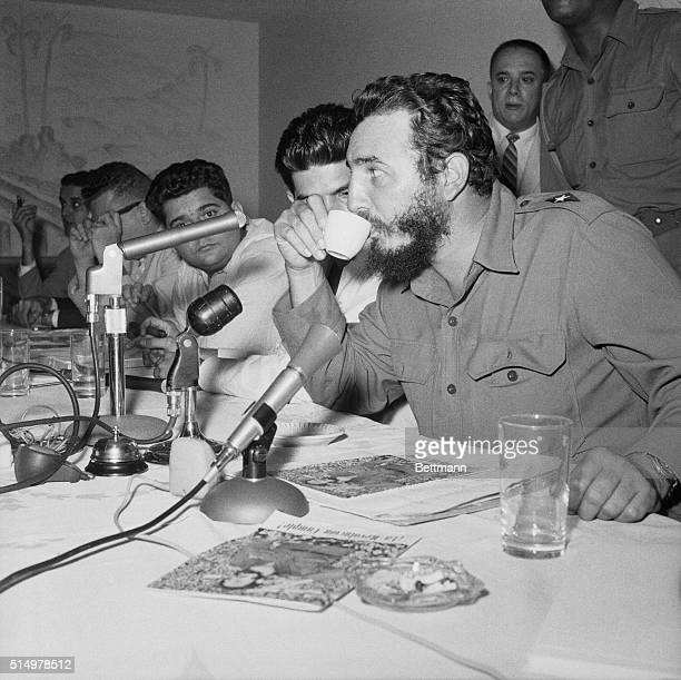 Cuban Premier Fidel Castro takes a coffee break at a press conference here at which he announced that he would personally attend 'if necessary' the...