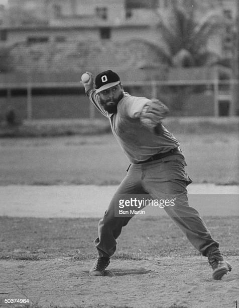 Cuban Pres Fidel Castro playing baseball on summer's day pitching for local team