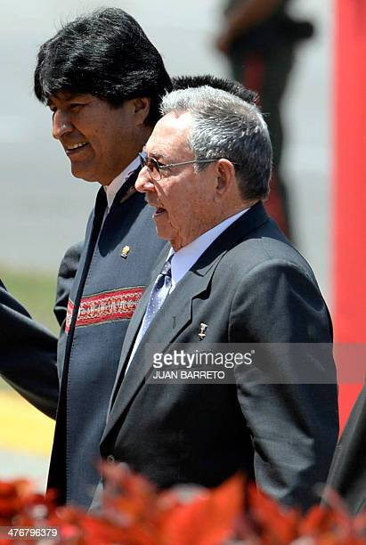 Cuban presiden Raul Castro and Bolivian president Evo Morales walk before a military parade in Caracas on March 5 2014 The Venezuelan government on...
