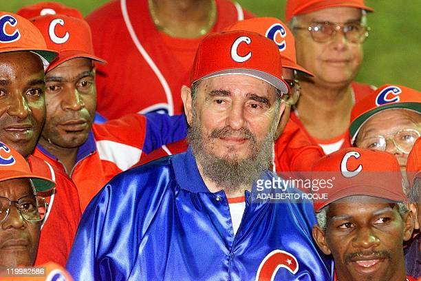 Cuban President and honorary coach Fidel Castro surrounded by his team smiles late 18 November 1999 after a friendly game between ball veterans from...