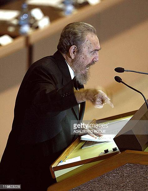 Cuban President Fidel Castro addresses the closing session the International Conference on Globalization 14 February 2003 in Havana Castro warned of...