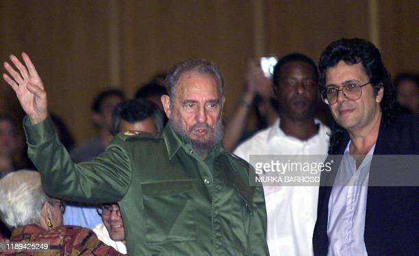 Cuban President Fidel Castro and Culture Minister Abel Prieto greet Cubans during a program 16 October 2002 in Havana. Musicians performed pieces...