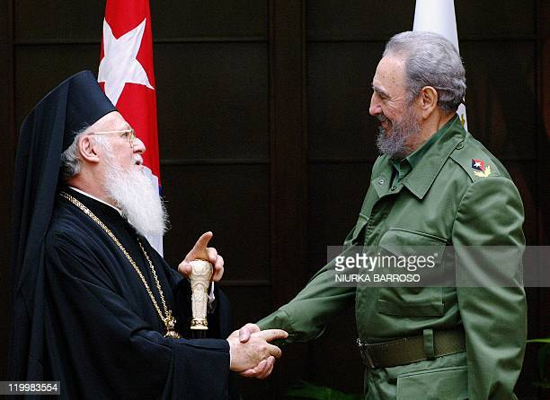 Cuban President Fidel Castro and Ecumenical Patriarch Bartholomew shake hands during the official ceremony at the Palace of the Revolution 21 January...