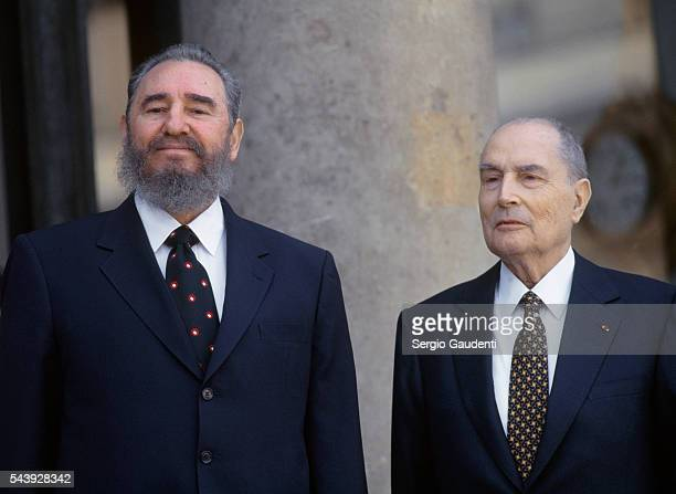 Cuban President Fidel Castro and French President Francois Mitterrand on the steps of the Elysee Palace during one of Castro's official visits to...