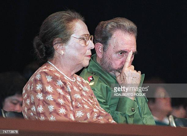 Cuban President Fidel Castro and his sisterinlaw deputy Vilma Espin attend the closing of the World Solidarity Meeting of Women 16 April 1998 in...