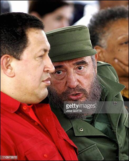 Cuban President Fidel Castro and Hugo Chavez President of Venezuela talk as they sign agreement on culture affairs between both countries in Havana...