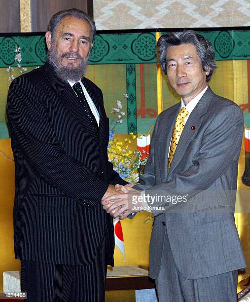 Cuban President Fidel Castro and Japanese Prime Minister Junichiro Koizumi shake hands at the Foreign Ministry's guest house March 2 2003 in Tokyo...