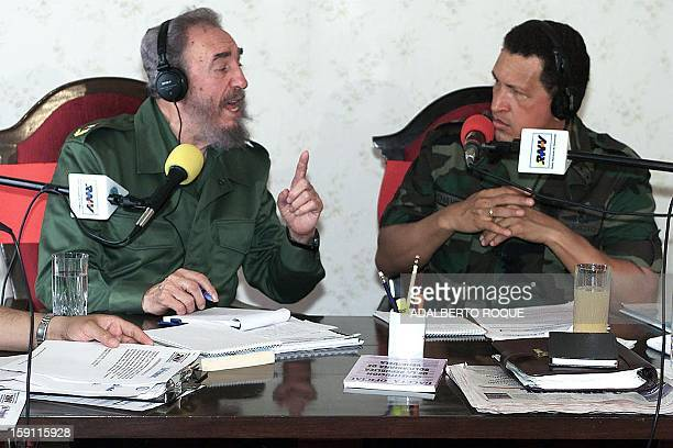 Cuban President Fidel Castro and Venezuelan counterpart Hugo Chavez confer 29 October 2000 in Valencia 200 kilometers east of Caracas Venezuela...