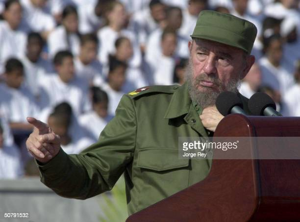Cuban President Fidel Castro arrives at a May Day celebration at Revolution Square May 1 2004 in Havana Cuba Organizers say one million people...
