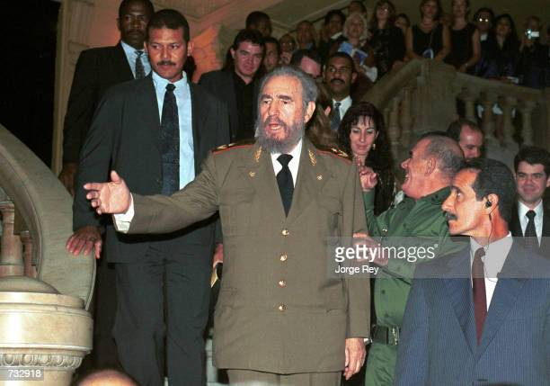 Cuban President Fidel Castro center attends the opening of the 17th Havana International Festival of Ballet October 20 2000 at the Grand Theatre in...