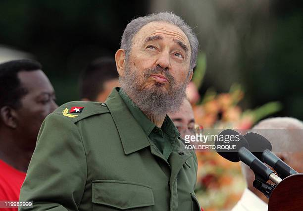 Cuban President Fidel Castro checks the weather by looking at the sky as he delivers a speech on July 26th at the Plaza de la Patria square in Bayamo...