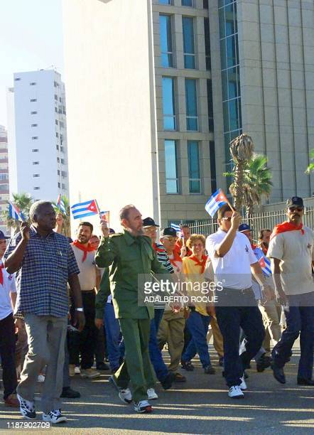Cuban President Fidel Castro , dressed with his usual uniform, leads thousands of Cubans in a march past the US Interests Section in Havana, Cuba, to...