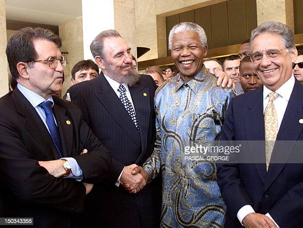 Cuban President Fidel Castro enjoys the presence of South Africa's President Nelson Mandela surrounded by Italian Prime Minister Romano Prodi and...