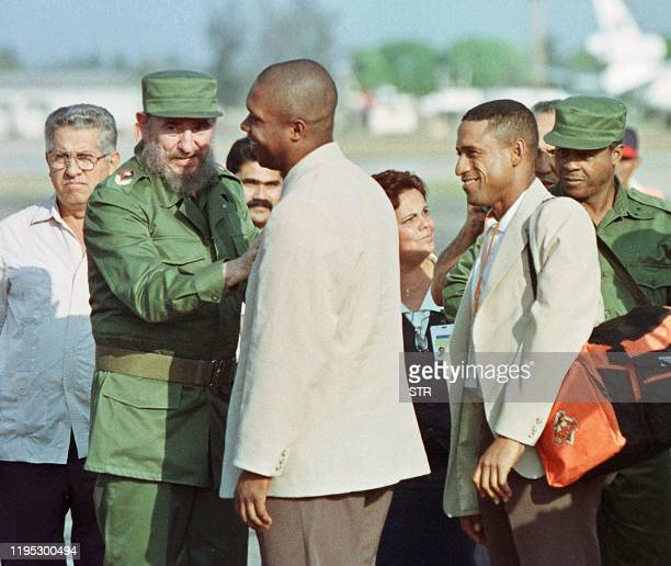 Cuban president Fidel Castro greets Omar El Nino Linares third base player of the Cuban National baseball team as teammate outfielder Luis Ulacia...