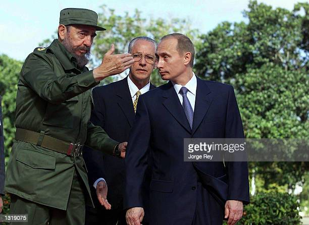 Cuban President Fidel Castro left welcomes Russian President Vladimir Putin to Cuba December 14 2000 at the Palace of the Revolution in Havana Cuba...