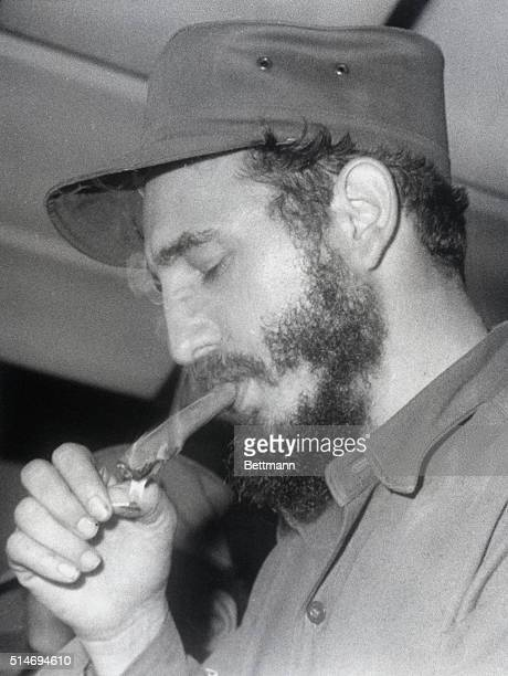 Cuban president Fidel Castro lights a cigar after a 1963 speech in which he urged all Latin Americans to imitate Cuba in revolt against their...