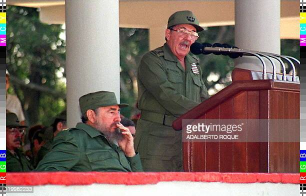 Cuban President Fidel Castro listens to a speech by his brother and Minister of the Armed Forces Raul Castro 07 December at the Mausoleum of Antonio...