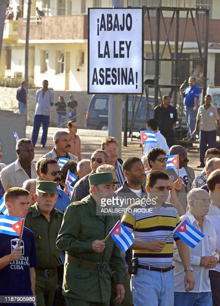 Cuban President Fidel Castro marches in downtown Havana 19 January 2001 as thousands of Cubans demonstrated against US Presidentelect George W Bush's...