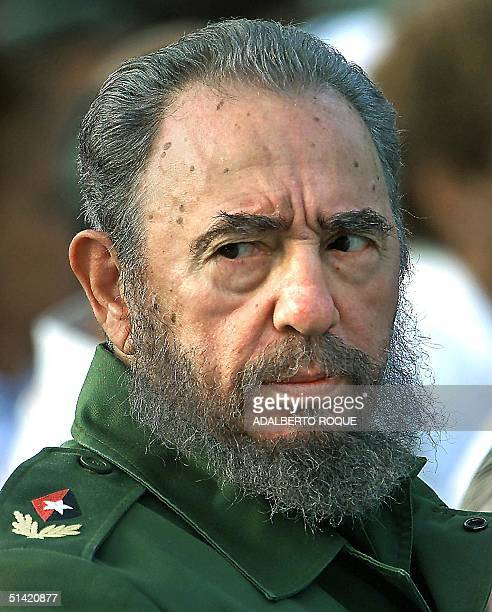 Cuban President Fidel Castro participates in the graduation of a class of medical students 13 August 2000 outside the United States Interests Section...