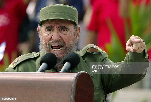 Cuban President Fidel Castro presides over a massive May Day demonstration at Havana's Plaza de la Revolucion 01 May 2005 More than one million...