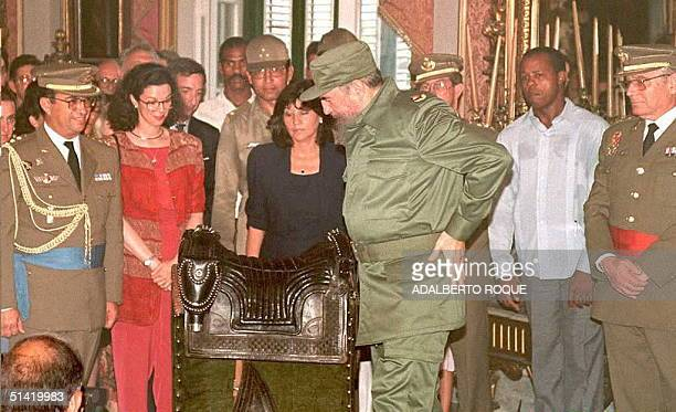 Cuban President Fidel Castro receives the saddle of Cuban revolutionary Lt Gen Antonio Maceo 08 June in Havana The saddle of the 19th Century hero...