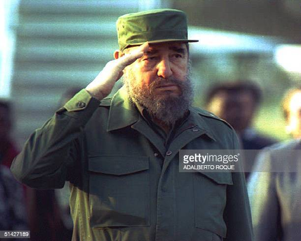 Cuban President Fidel Castro salutes during a welcoming ceremony for Zambian President Frederick Chiluba at Havana's Jose Marti airport 25 April 1994