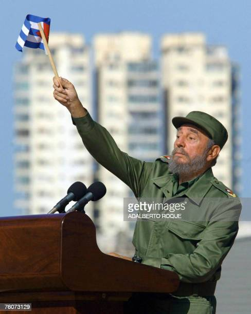 Cuban President Fidel Castro salutes the public during a rally in front of the US Interest Section in Havana 21 June 2004 Castro turns 81 on August...